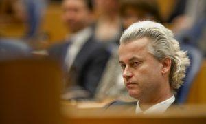 Anti-immigration politician Geert Wilders listens during a debate in the Dutch parliament about the government's resignation caused by a crisis over budget cuts in The Hague April 24, 2012. Prime Minister Mark Rutte offered his minority Liberal-Christian Democrat coalition's resignation to Queen Beatrix of the Netherlands after a split with the populist Freedom Party of Wilders, opening the way for early elections. REUTERS/Robin van Lonkhuijsen/United Photos (NETHERLANDS - Tags: POLITICS)